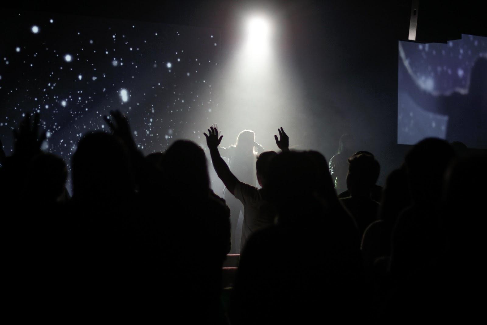 Concert  with spotlight on singer