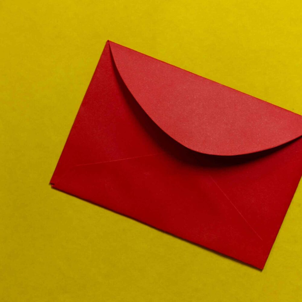 Red envelope on green surface