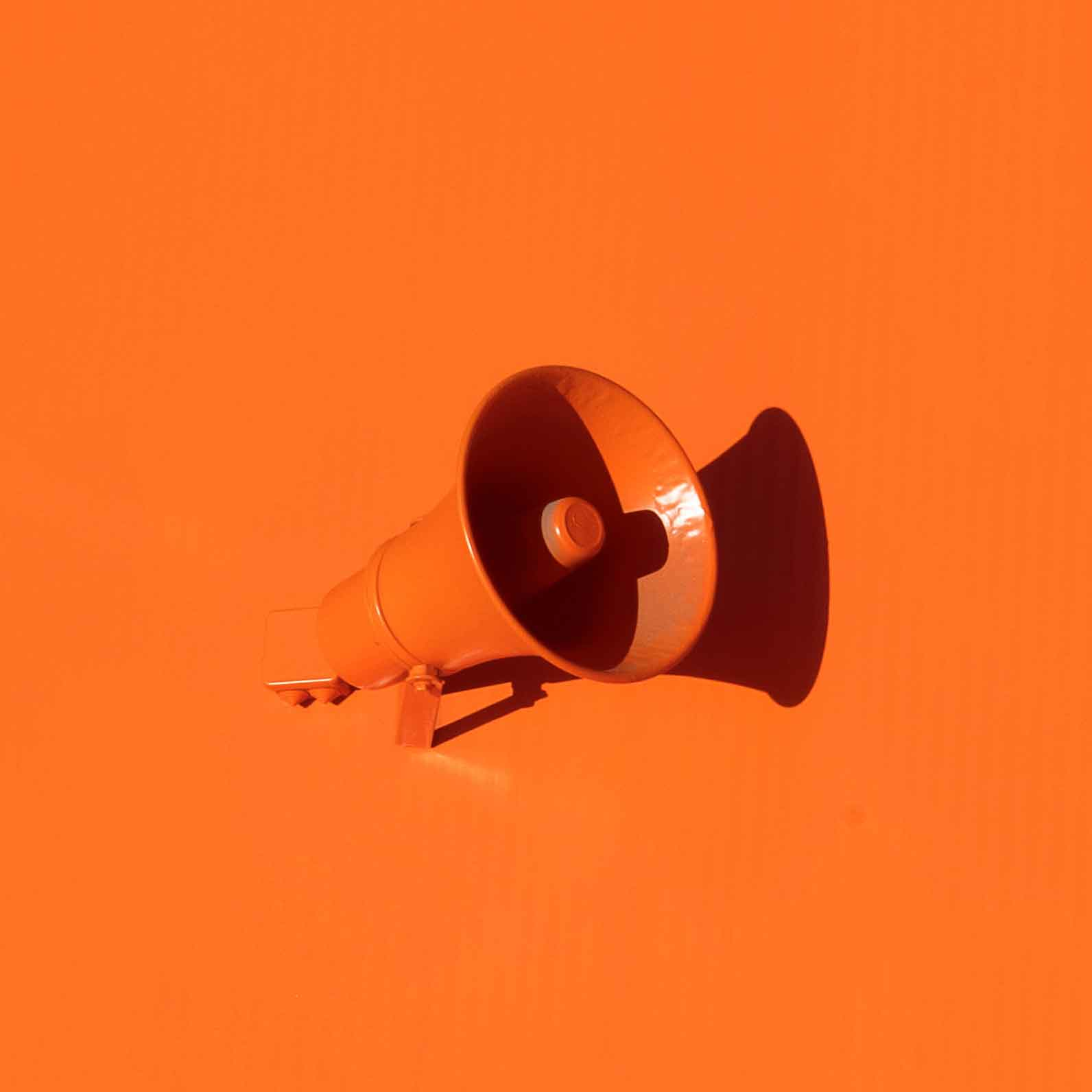 Organge megaphone on an orange background